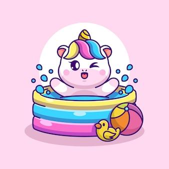 Süßes einhorn, das in einem aufblasbaren pool spielt