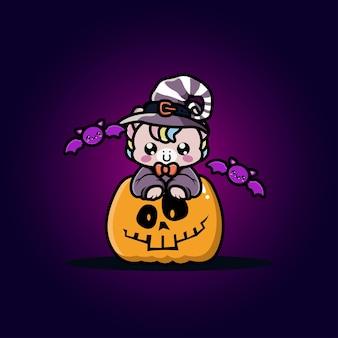 Süßes einhorn mit halloween-kürbis-cartoon