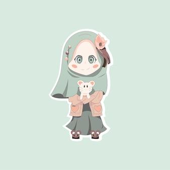 Süßes hijab-mädchen mit ihrer puppe