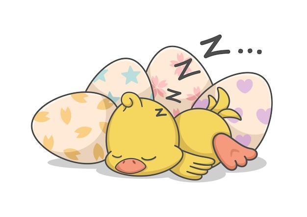 Süßes hühnerküken, das durch ostereier schläft