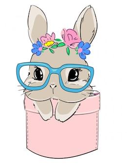 Süßes kaninchen in gläsern sitzt in einer tasche. druckdesign für textilien, babykleidung, banner.