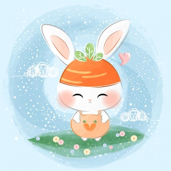 Süßes kleines kaninchen mit karottenhut
