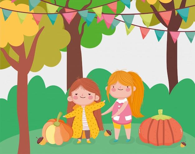 Süßes kleines mädchen im park mit kürbissen