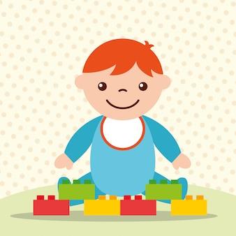 Süßes kleinkind junge mit blöcken ziegel spielzeug
