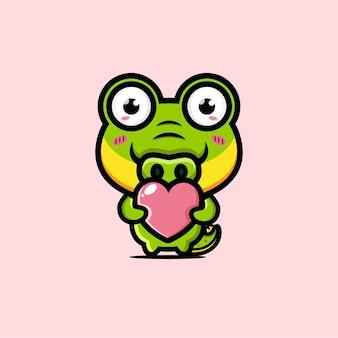 Süßes krokodil, das ein liebesherz umarmt