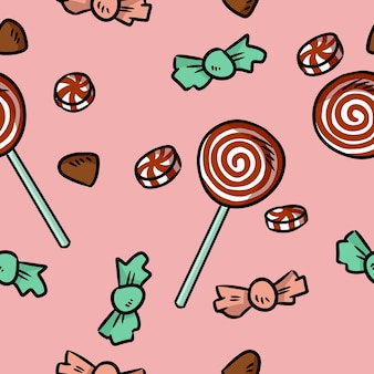 Süßes nahtloses muster der bonbons und der süßigkeiten. hand gezeichnete weihnachtskarikatur kritzelt hintergrund