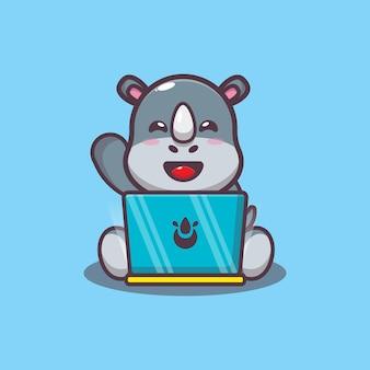 Süßes nashorn mit laptop-cartoon-vektor-illustration