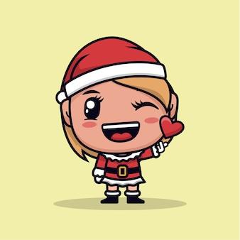 Süßes weihnachtsmädchen mit liebe