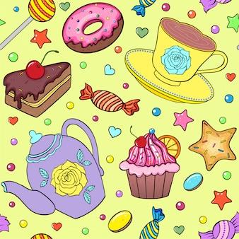 Süßigkeiten, teekanne und tasse