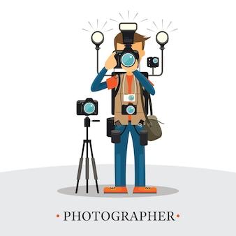 Super equipment fotograf, mann hält und zielt kameras, trägt zu viele zubehörteile