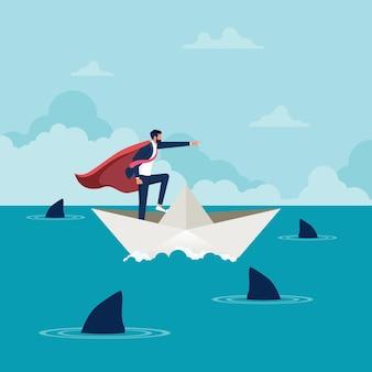 Super geschäftsmann auf einem papierboot unternehmensführung und zielorientiertes konzept
