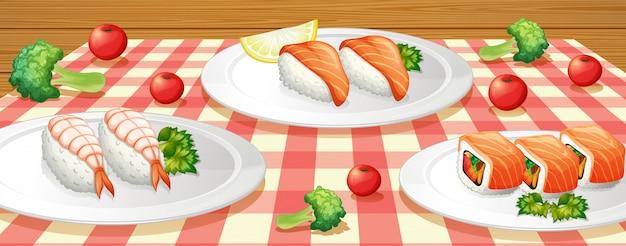 Sushi auf platte bei tisch