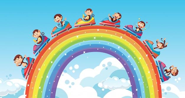 Szene mit glücklichen affen, die autos über dem regenbogen reiten