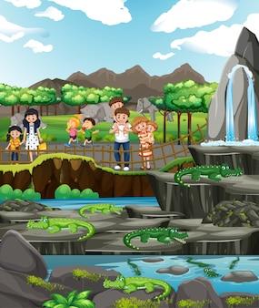 Szene mit krokodilen und vielen kindern