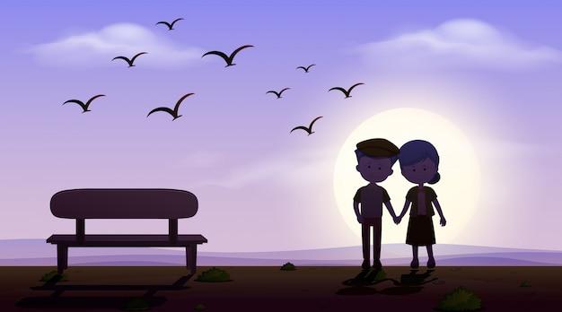 Szene mit liebespaar, das hand bei sonnenuntergang hält