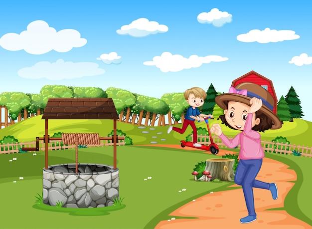 Szene mit zwei kindern, die auf dem feld laufen und roller spielen