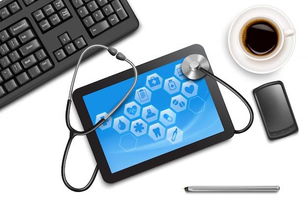 Tablet-bildschirm mit medizinischen symbolen und stethoskop auf dem tisch beim arzt ..