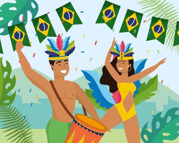 Tänzerinnen und tänzer mit trommel und kostüm