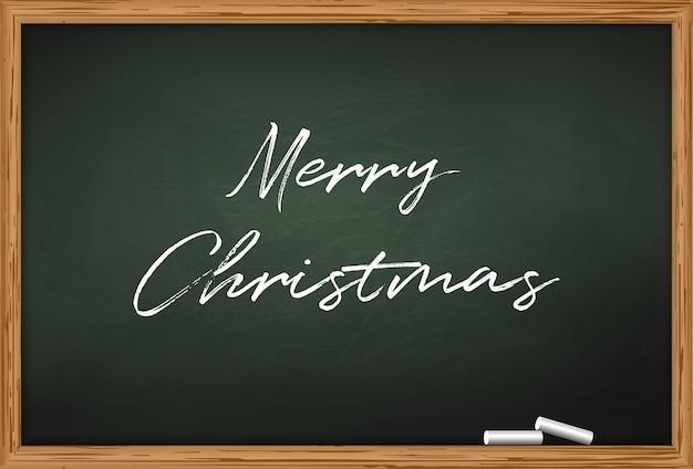 Tafel mit zwei stücken kreide und aufschrift frohen weihnachten