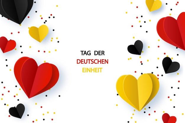 Tag der deutschen einheit tag der deutschen einheit hintergrund mit deutschlandflaggen herzform und konfetti