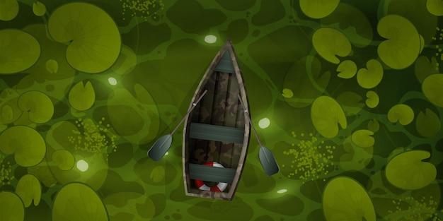 Tarnboot schwimmt mit seerosenblättern durch den sumpf,