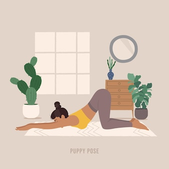 Taubenpose junge frau, die yoga-pose praktiziert
