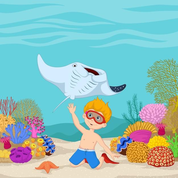 Tauchen des kleinen jungen der karikatur im tropischen unterwassermeer