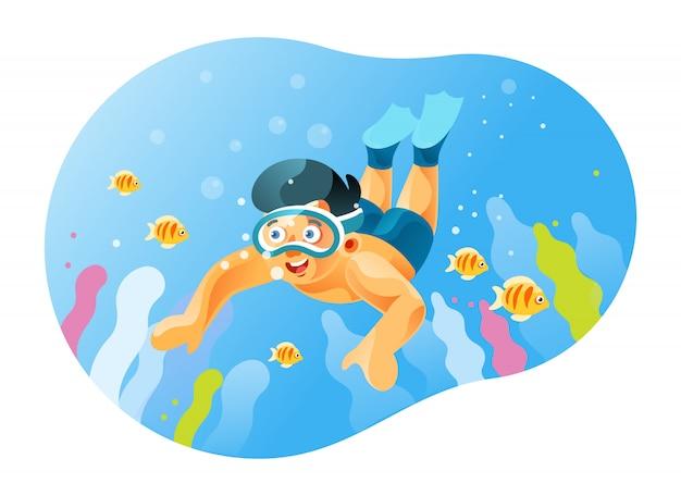 Taucherjunge sieht die schöne unterwasserlandschaft