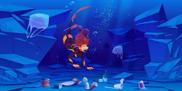 Tauchermädchen im ozean mit plastikmüll unten.