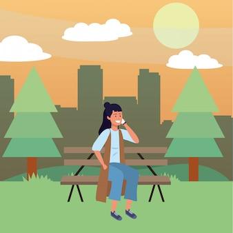 Tausendjährige person, die auf parkbank sitzt