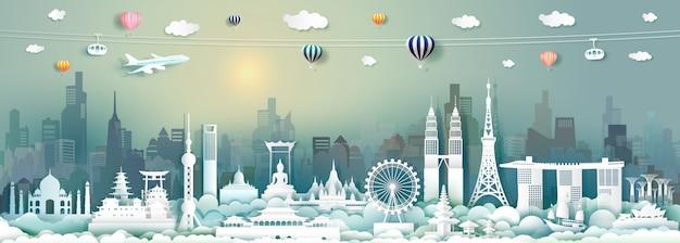 Tavel-architekturmarksteine von asien mit wolkenkratzer und sonnenaufgang im papierschnitt