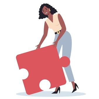 Teamwork-konzept. geschäftsfrau, die stück des puzzles hält. zusammenarbeit, kommunikation und lösung der arbeitnehmer.