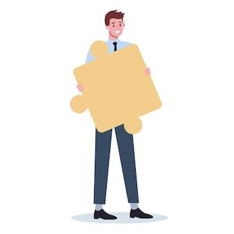 Teamwork-konzept. geschäftsmann, der stück des puzzles hält. zusammenarbeit, kommunikation und lösung der arbeitnehmer.