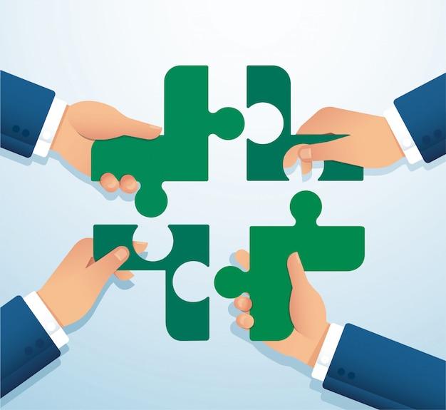 Teamwork-konzept. leute, die das verrückte symbol des puzzles zusammensetzen