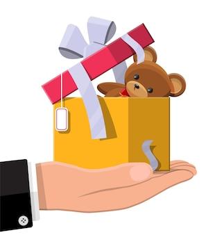 Teddybär innerhalb der geschenkbox lokalisiert auf weiß