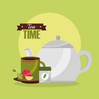 Teekanne und tasse mit zitronenlöffel und teebeutel