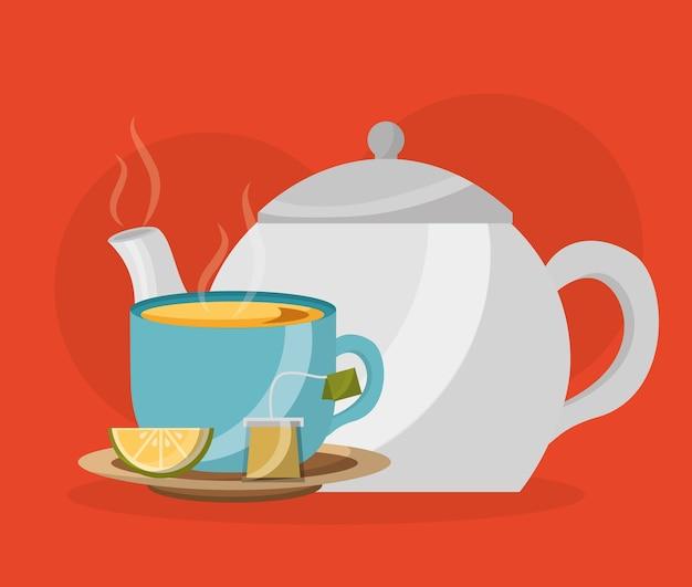 Teekanne und teetasse mit zitrone und teebeutel