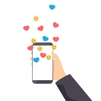 Telefon in der hand mit herzen und lächeln