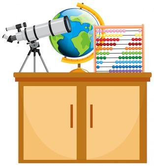 Teleskop und globus auf dem holzschrank