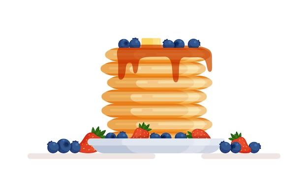 Teller mit pfannkuchen mit honig und beeren bewässert.
