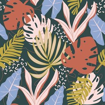 Tendenzielles abstraktes nahtloses muster mit bunten tropischen blättern und anlagen auf grün