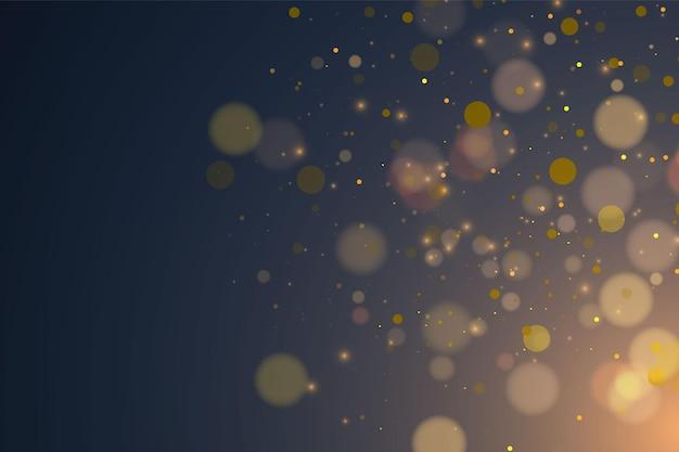 Texturglitter und elegant für weihnachten. funkelnde magische goldgelbe staubpartikel. magisches konzept. abstrakter transparenter hintergrund mit bokeh-effekt.