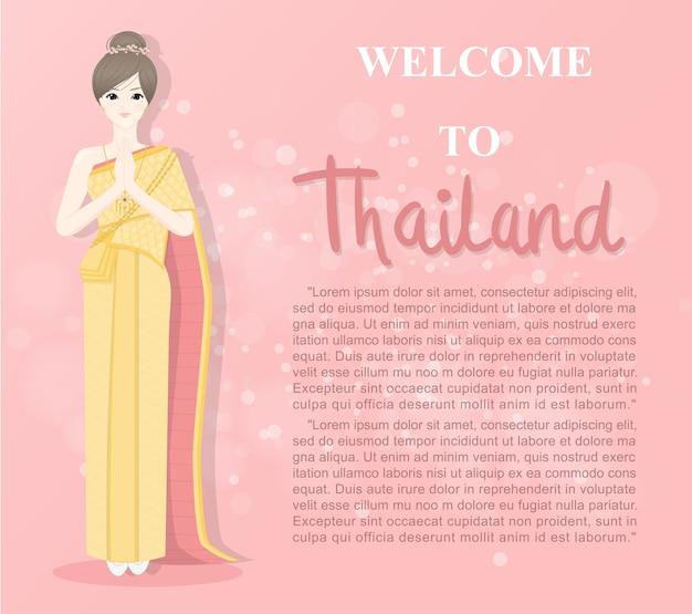Thailändische dame in den thailändischen traditionellen kostümgrüßen in der thailändischen art nannte sawaddee