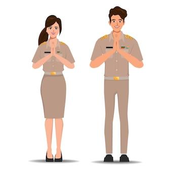 Thailändische regierung oder thailändischer lehrercharakter in bangkok thailand namaste pose zur begrüßung.