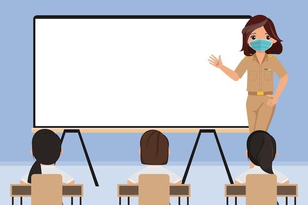 Thailändischer schüler und lehrer zurück zur schule mit neuem normalen konzept