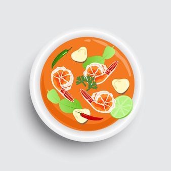 Thailändisches lebensmittel tom yum kung auf schüssel. draufsichtdesign der thailändischen würzigen suppe.