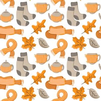 Thanksgiving day nahtloses vektormuster von herbstblättern, gestrickten socken und schal, teekanne mit tassen