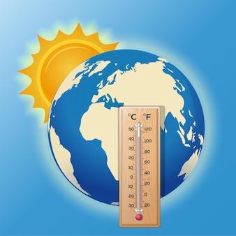 Thermometer der welt. die sonne beleuchtet die erde. hohe temperatur am thermometer. erderwärmung.