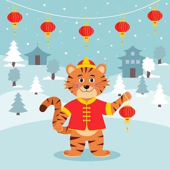 Tiger im traditionellen chinesischen kleid hält eine chinesische laterne. winterlandschaft und eine girlande aus chinesischen laternen. neujahrskarte.