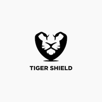 Tiger schild logo design-vorlage. tiger negatives raumlogo. Premium Vektoren